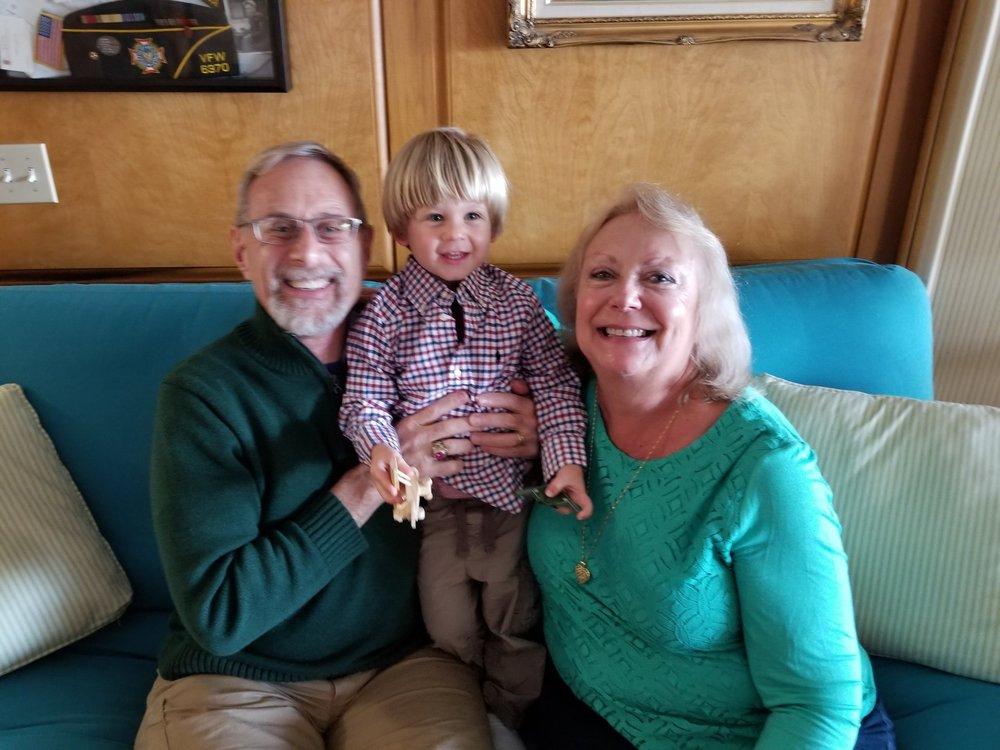 Dalia, her husland, and precious grandson.