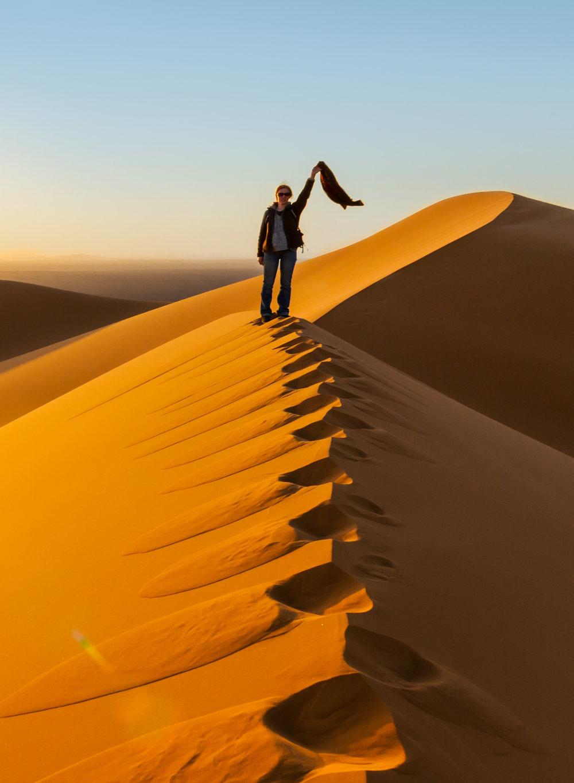 Dunes-Sahara-woman-standin--iStock-5373877480-crop.jpg