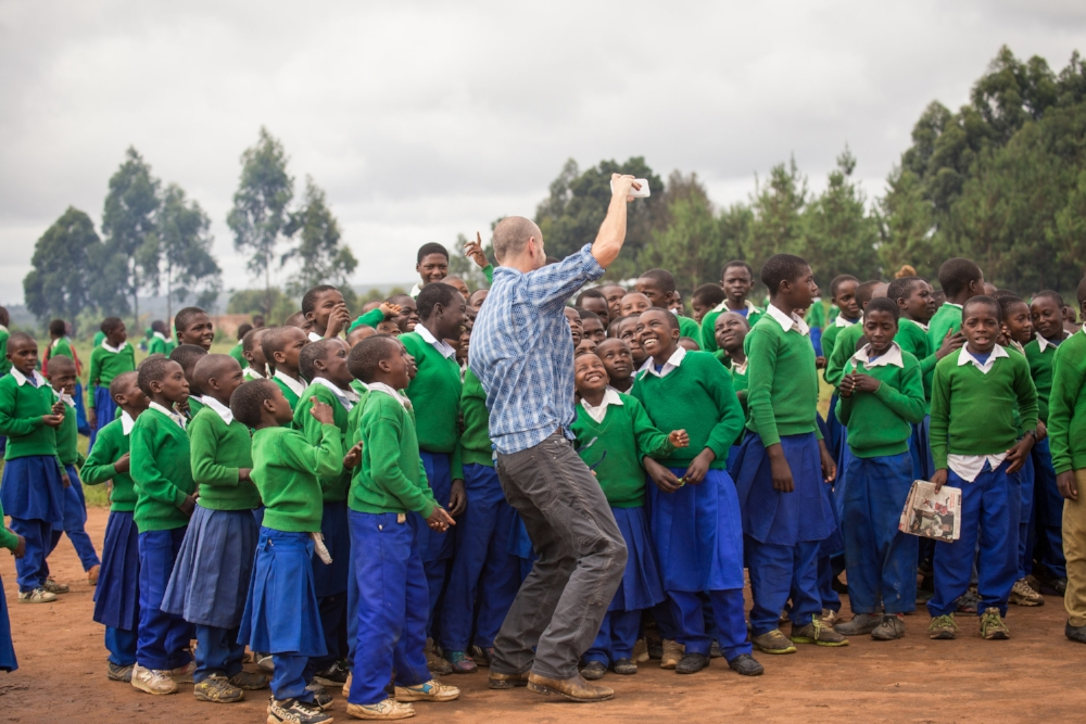 UNICEF Tanzania field trip participant, David Bonnette, stealing a selfie with school children | Photo credit: Rob Beechey