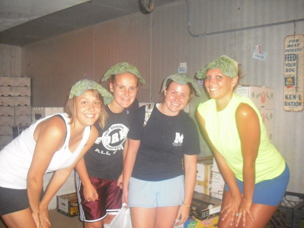 Friends wearing cabbage hats inside the cooler.