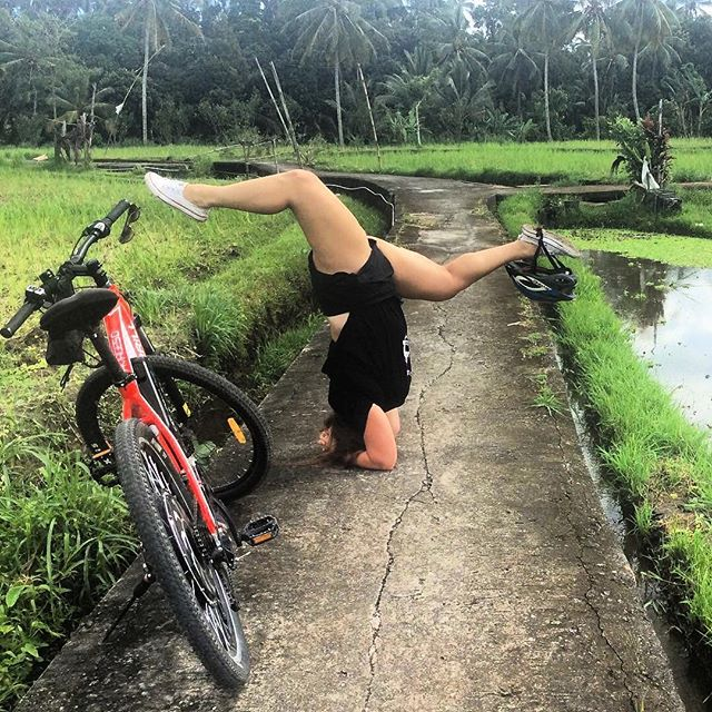 You don't have to be able to bike and stand on your head in a rice field to travel with us, but we won't stop you! 😂🍚 Come join us for a wild ride in Bali May 21-26! ☝🏼link in profile for more info! Ps- we offer more activities on this trip than anyone we know! #letsgo