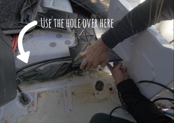 In the video, I point to this hole. When I got under there, I realized there was a way better hole that dropped that fuel pump line right inside the fuel tank's heat shield area making it easy to run to the fuel pump wiring to the fuel pump.