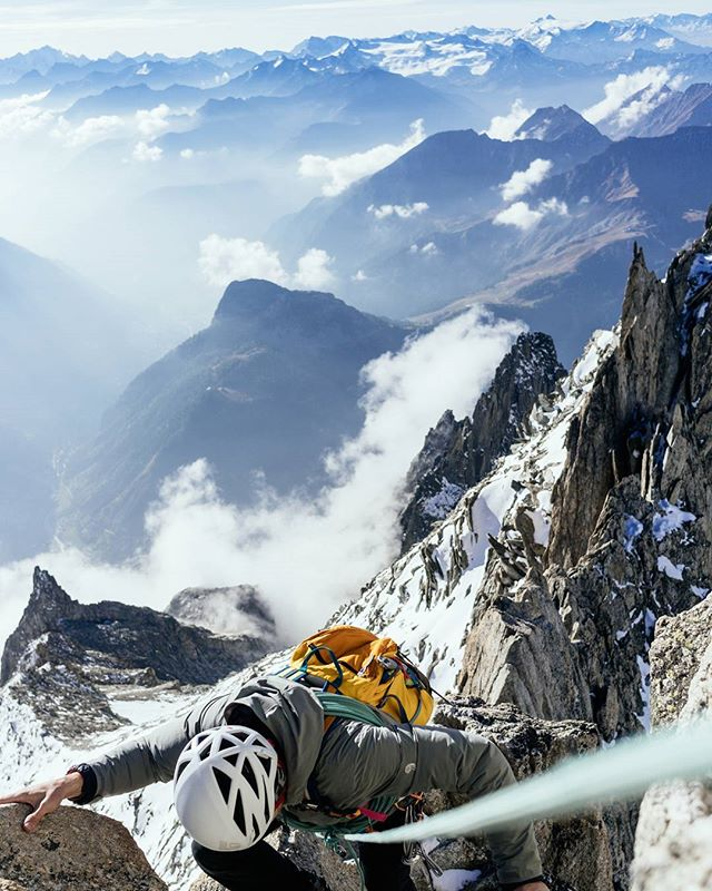 What's more fun than simulclimbing exposed, knife-edge alpine ridgelines? Lines that straddle the border of two countries in the heart of the Alps? I can't think of much.  Here @taylormichaelburk makes some moves along the Aiguille D'Entreves (while @chadofutah and @hayoui bring up the rear) which is probably one of the most aesthetic ridgelines in the world. Those peaks in the background are the Italian Alps - layers upon layers through Gran Paradiso; not seen (behind me) is the Vallée Blanche, which we traveled across from Chamonix.  Tag a friend who you'd like to climb this ridgeline with.