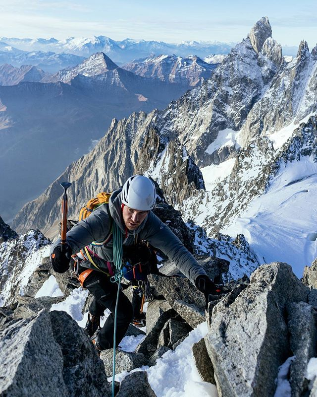 "Looks, it's another #dailydose of @taylormichaelburk's alpine send-fest on the Arête D'Entreves.  What's fun about this route is that there are so many transitions between scrambling, snow slopes, steep & technical rock, and downclimbing - and all in crampons, that sometimes it's easier to just use your axe to ""hook"" onto a boulder like Taylor is doing here, than to put your tool down to scramble with both hands.  Ahhhh I love this route. @hayoui and @chadofutah did too. How badly do you wanna be on this ridgeline?"