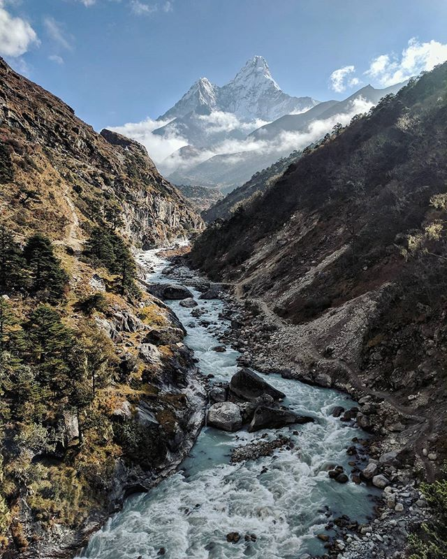 "Over the course of a week and as we gained elevation, lush sub-tropical rainforest gave way to sub-alpine, which then gave way alpine - the latter of which, being why we came.  Here, Ama Dablam (which translates to ""Mother's Necklace"") towers over the Khumbu, welcoming travelers into the high alpine valleys. This is one of those views that never gets old.  #SearchingForScale"