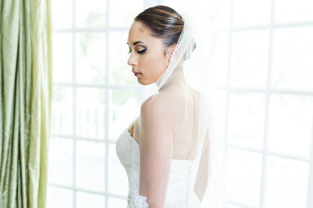 A wedding, engagement, love, newlywed image of a bride in her wedding dress -  taken by Miami Wedding Photographer, Javier Edwards of El Roi Photo, in Miami, Florida, for a Miami Wedding