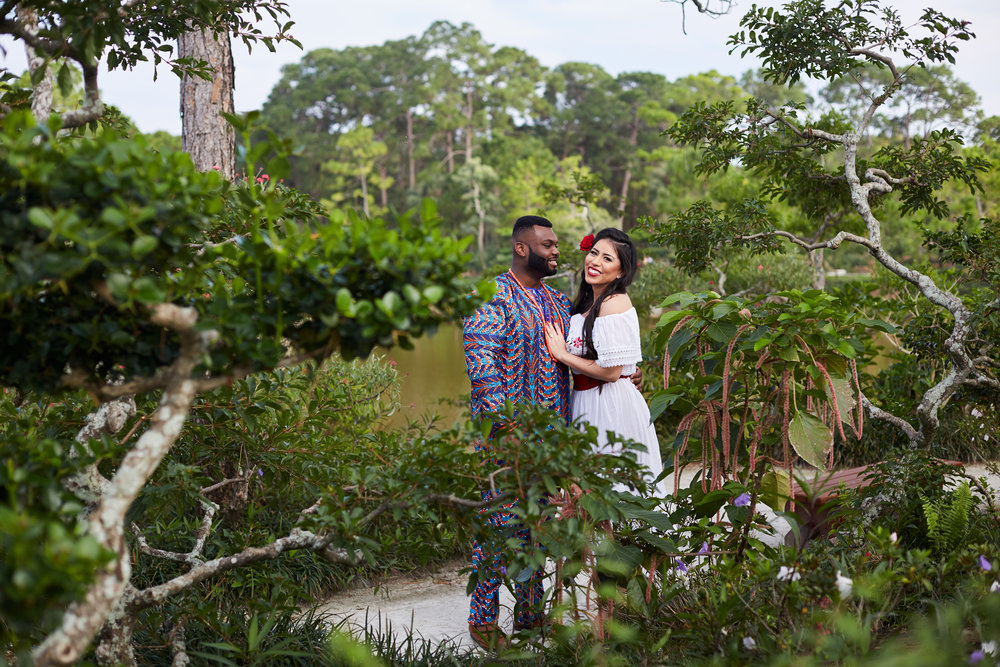 A wedding, engagement, love, newlywed image of a bride in her wedding dress with African groom -  taken by Miami Wedding Photographer, Javier Edwards of El Roi Photo, in Miami, Florida, for a Miami Wedding