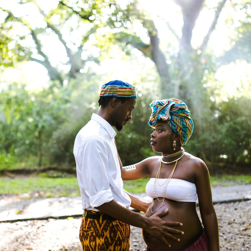 Maternity image of a black, african, haitian couple. Image taken by Javier Edwards of El Roi Photo, in Tree Tops Park, located in Davie Florida.