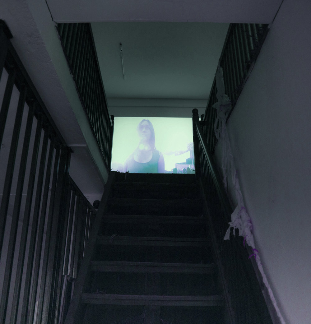 Stairway to upper floor with video projections of  Ma (part 1-4) .