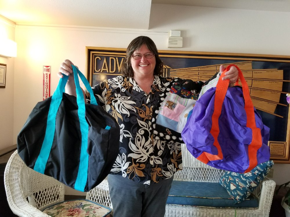 Pam Lansford shows off some of the donations from Spring Creek Middle School.