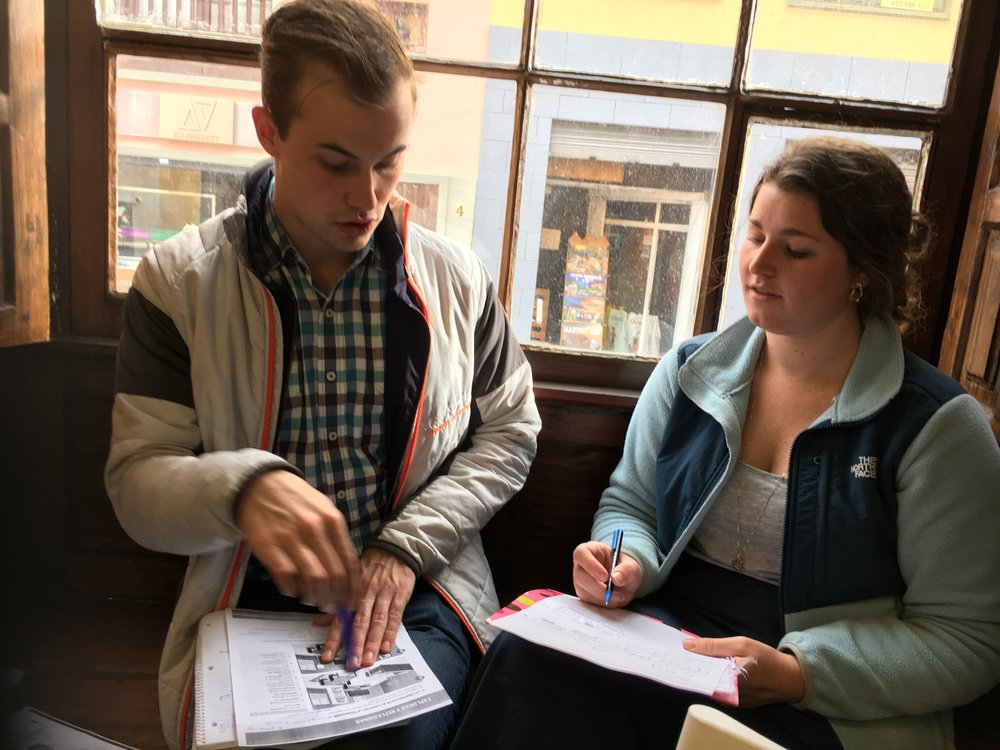 Pure Study Abroad Fellows Christian & Katy (Winter '17) during class small group time