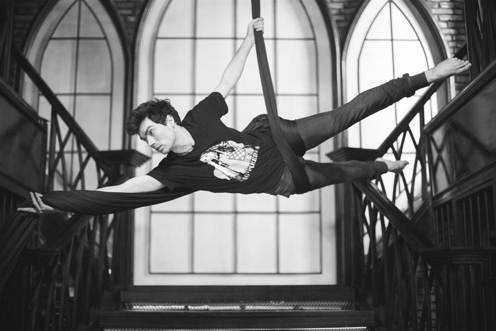 - A House member rehearses aerial silk choreography / Image courtesy of Robert Michael Evans / Journalist, Celeste Kriel
