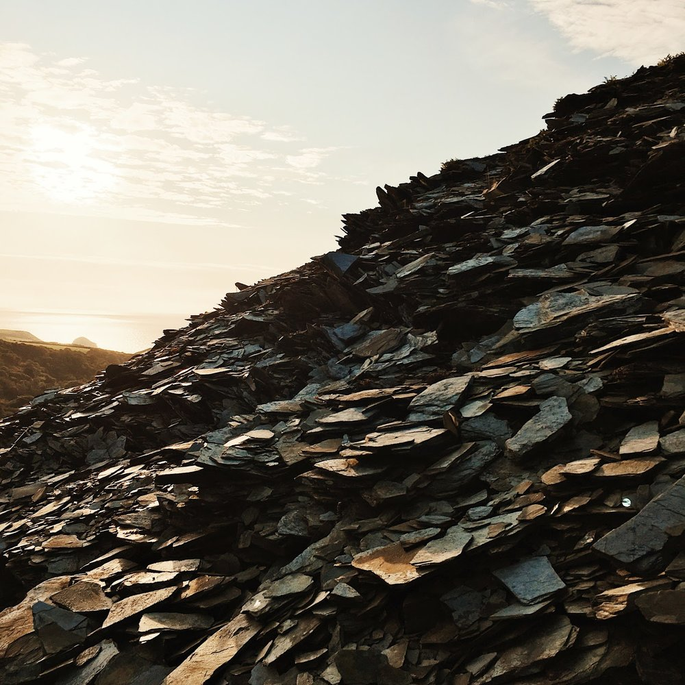 The piles of slate around the site glimmer in the sun