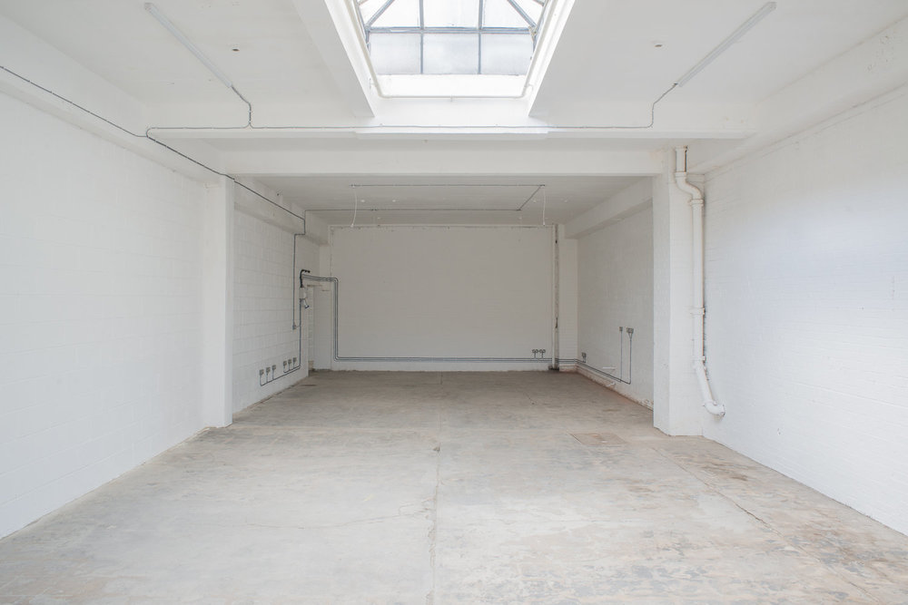 Nestled among a creative community in the heart of Hackney Wick, the space offers a very large ground floor warehouse unit which is versatile and available for short, medium or long term hire.   Perfect for filming, photo shoots & private events.  Large ground floor unit within complex of studios.  Dimensions: 175 m2 (25m x 7m); 1883 sq ft (82ft x 23ft)  Ceiling height 3.6m / 11.5ft. Two skylights.  63 amp single phase power. Sink and water.  Parking available in the front yard.    CONTACT   studios@growhackney.co.uk