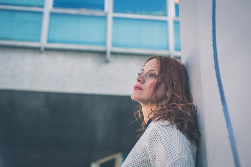 beautiful-girl-posing-in-the-city-streets-PWCTXJS.jpg