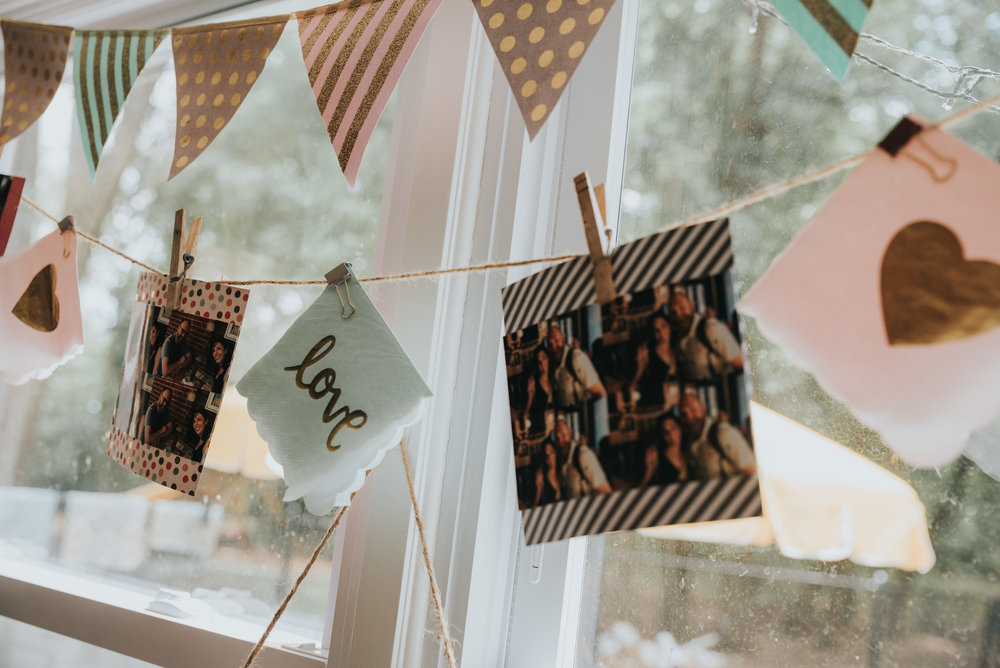 "I used cute ""love"" napkins in the garland and pics I printed out from the couples' website."