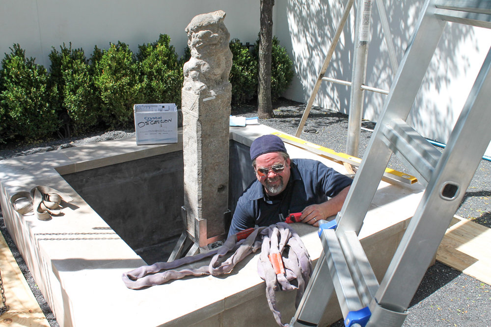 Installing the sculpture in its pedastal.