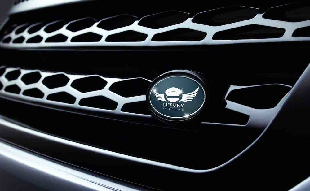 Luxury-in-motion-chauffeur-service-surrey-our-vehicles-land-rover-discovery-sport-front-grill-image.jpg