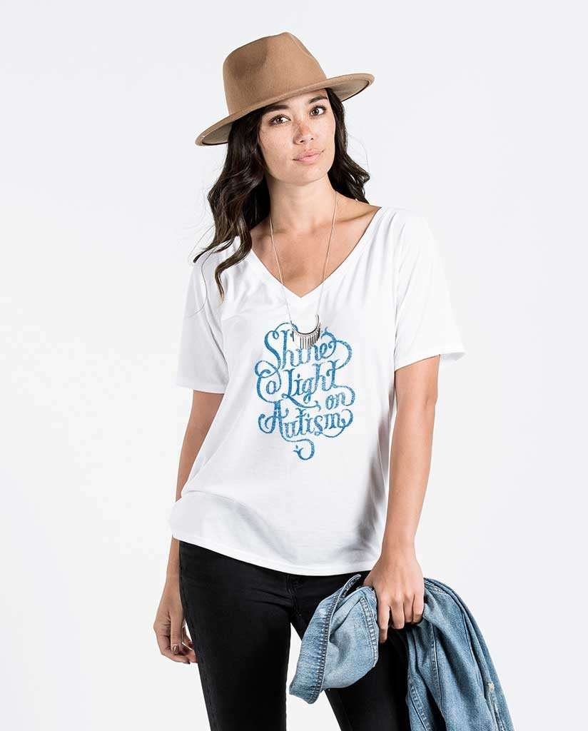 D5005696-ShineALight_Cursive_blue_only-NA-BC-8815-WomensSlouchyVNeckTee-Womens-White.jpg
