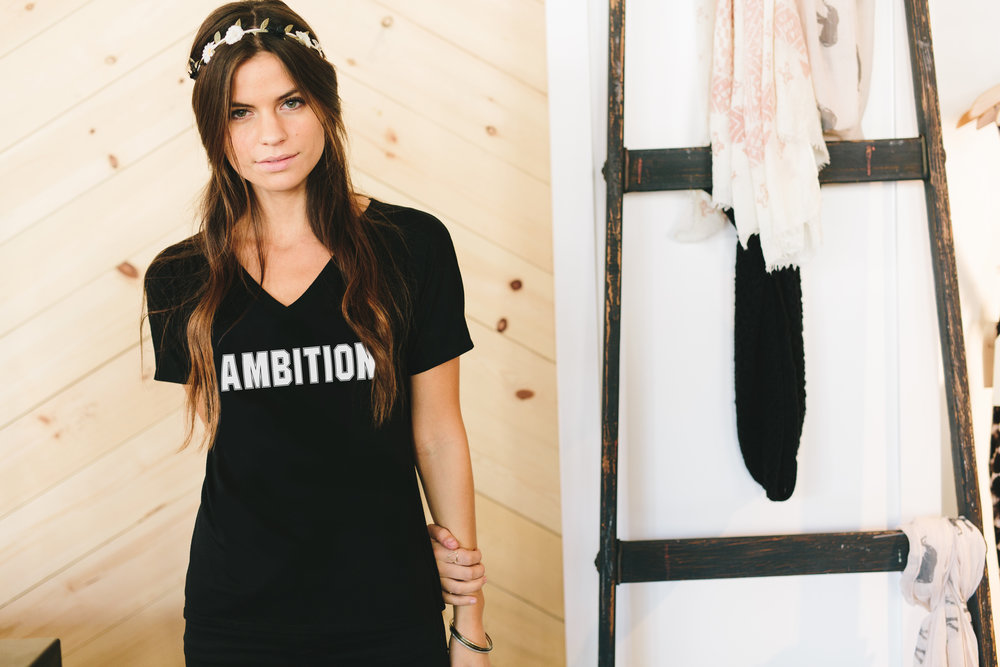 ambition_white_flowyvneck_black.jpg