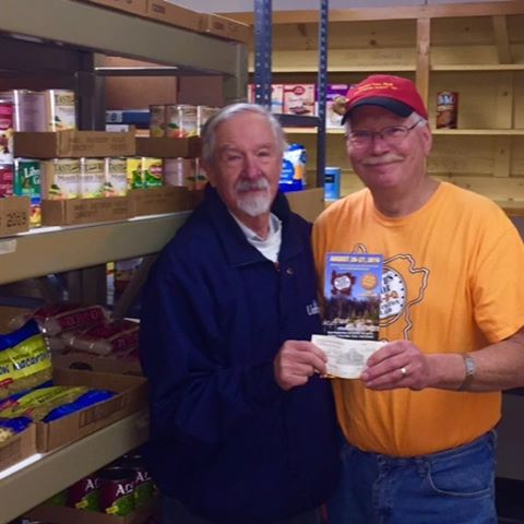 Washington Island Food Pantry, John Davies accepting $1000 donation from Dick Jepsen Death's Door BBQ