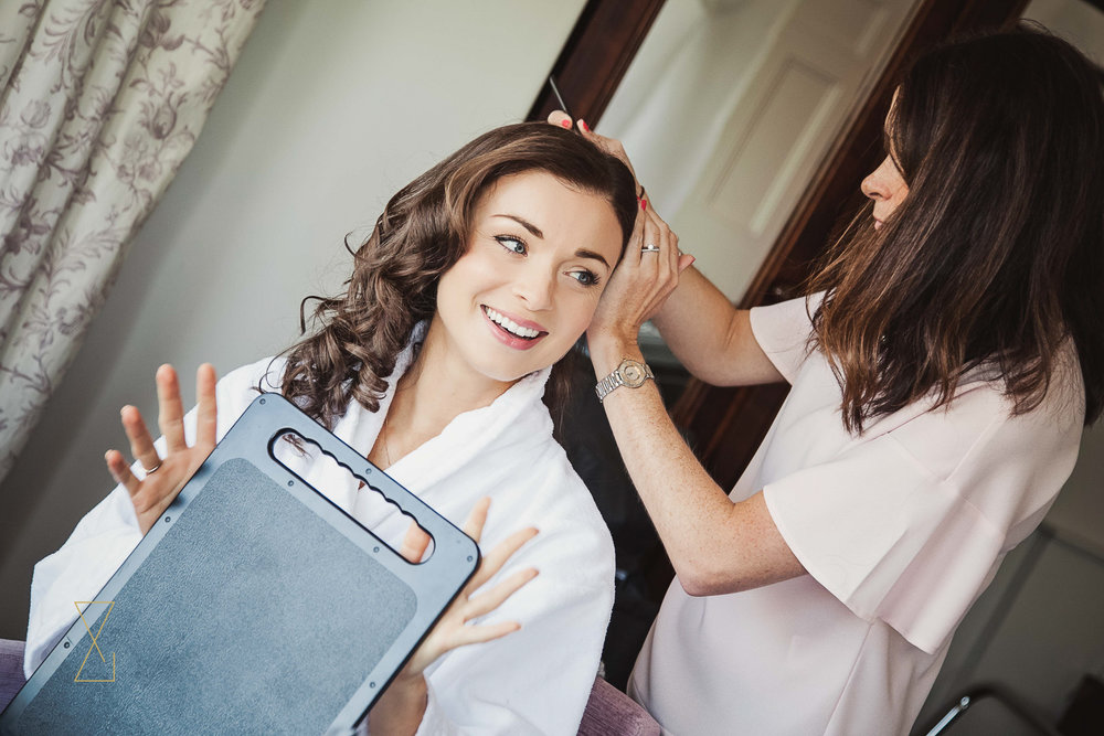 Excited bride getting ready on the day of her wedding at Laura Ashley Belsfield, Evans & Evans wedding photography