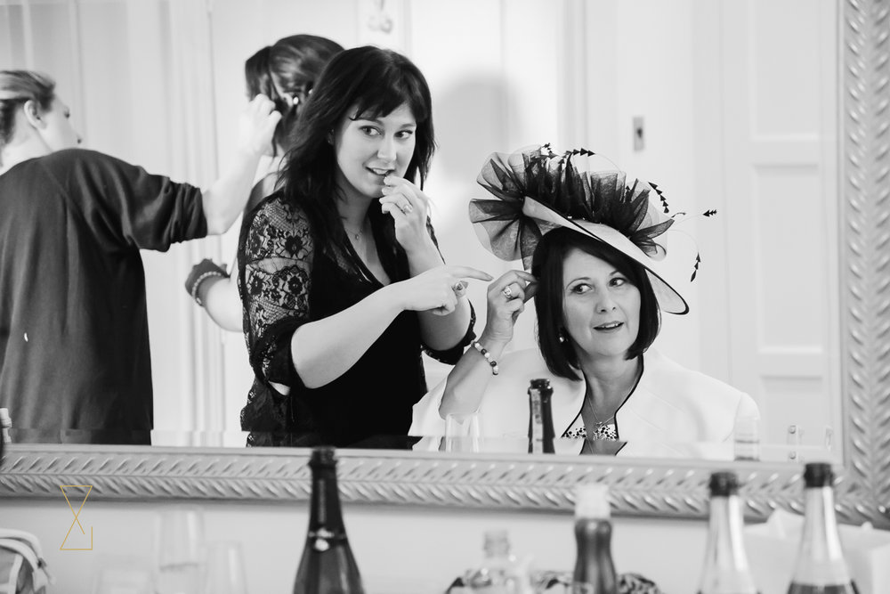 Mother of the bride having her hair done at Colshaw Hall Cheshire, Evans & Evans wedding photography