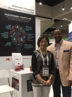 Lily Qi and Steven Walker of Biologics Consulting at MCEDC Booth.jpg