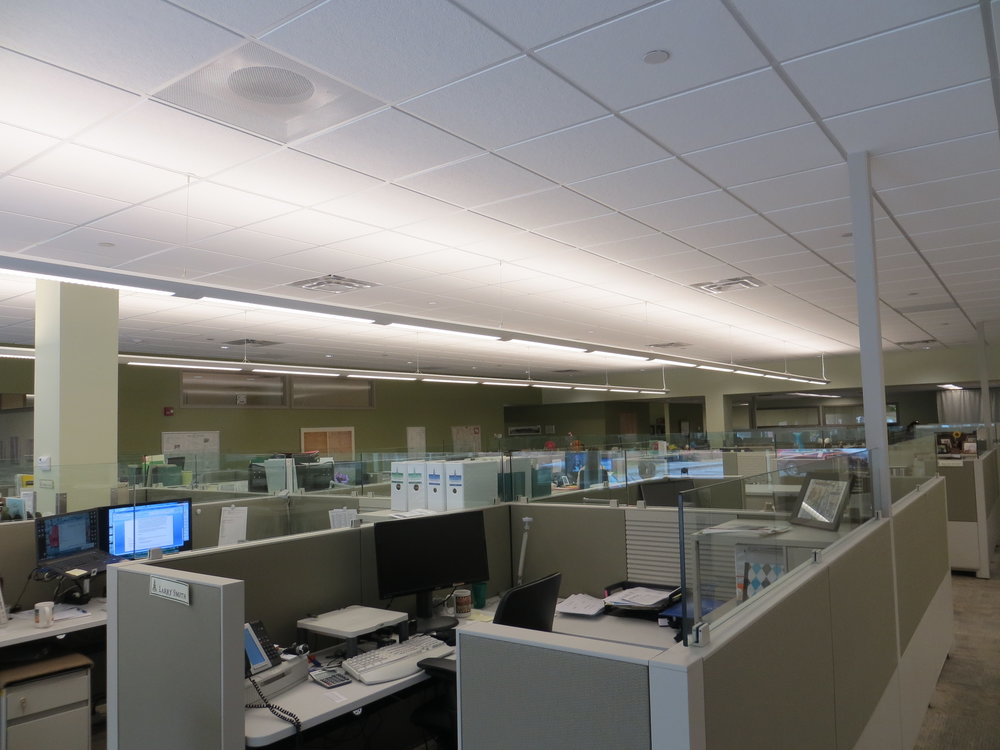 Workstations with fabric and interior sound insulation contribute to more effective, quieter open work environments in conjunction with widely adopted and bought into workplace etiquette and protocol strategies.  Note also a sound masking system was installed with high performance acoustical ceiling tiles and modular carpet tiles.  (Vermont League of Cities and Towns offices)