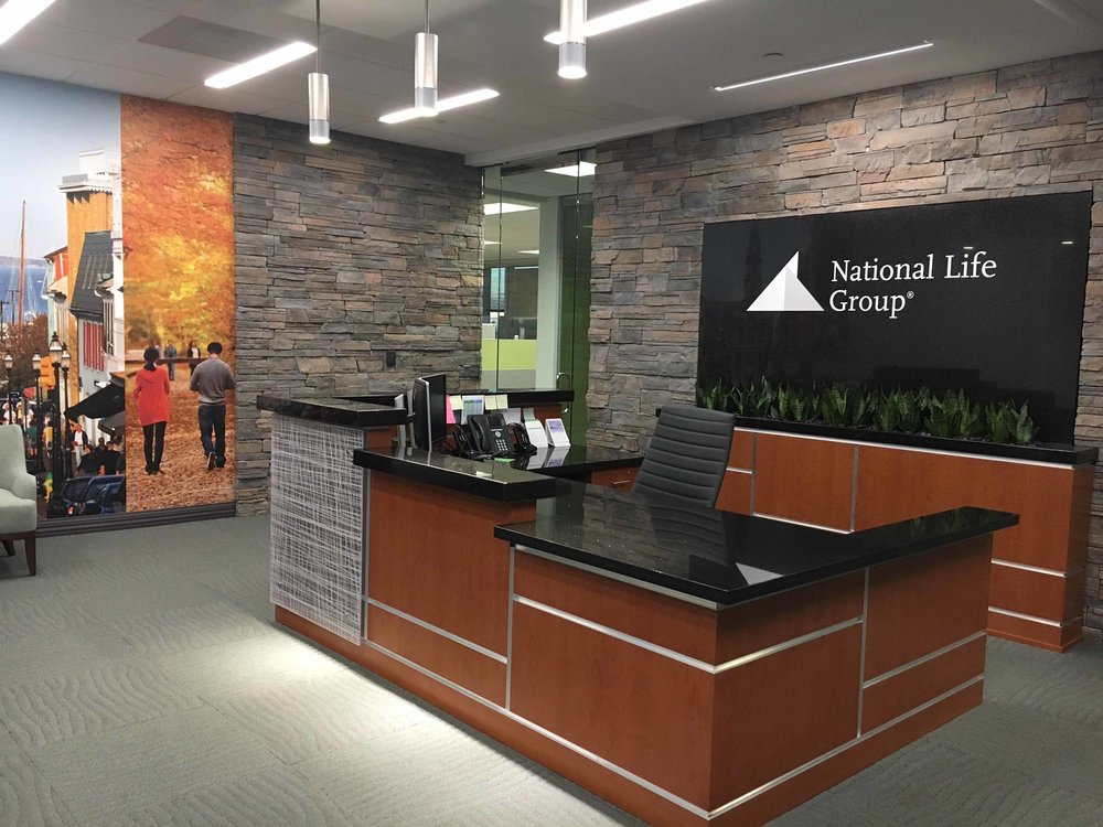 View of finished reception desk, planter, wall backdrop and photo mural