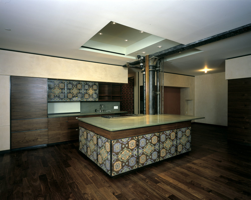 Kitchen with hand silk-screened glass and overlapping walnut panels, New York