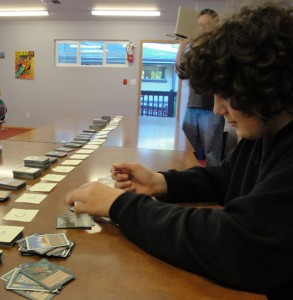 Student playing Magic, the card game.