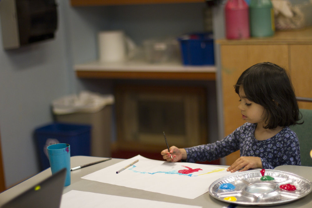 Child painting in the art room.