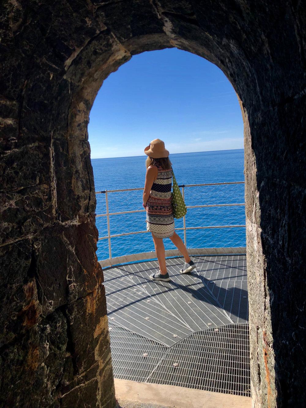 Jenny stops along the bike path to enjoy the views of the ligurian sea