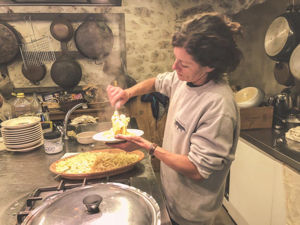 Francesca prepares homemade pasta with fresh truffle sauce