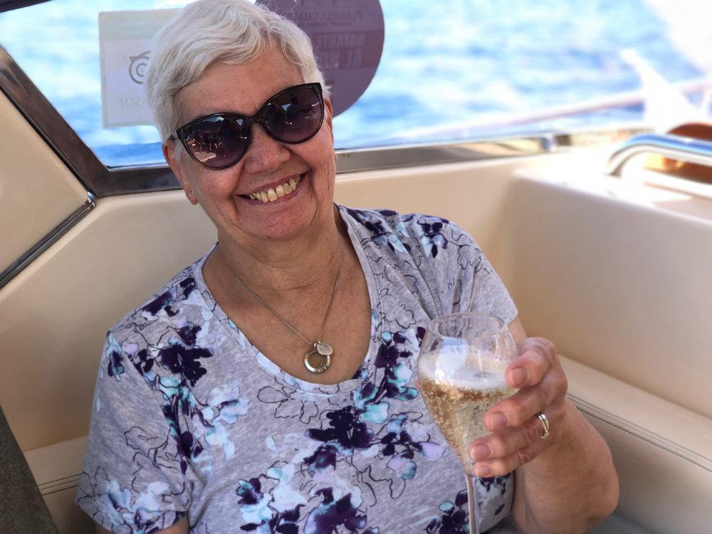 chris enjoys a bubbly while cruising the amalfi coastal waters