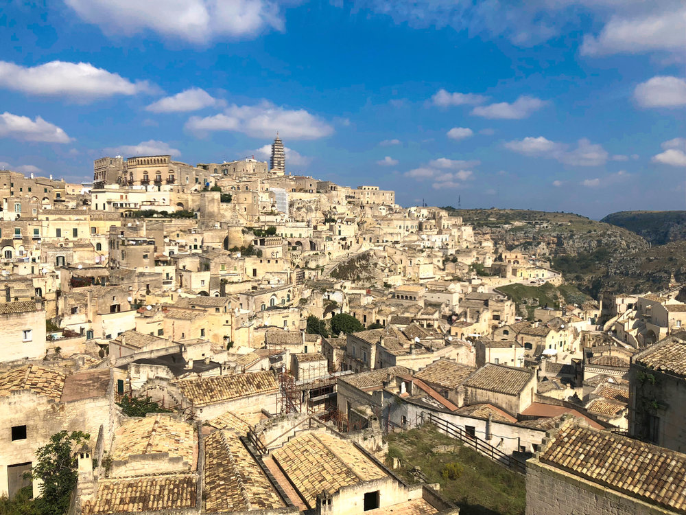 """Matera's ancient town, known as the """"Sassi di Matera"""". The Sassi originated in a prehistoric settlement, and the cave-like dwellings are thought to be among the first ever human settlements in italy."""