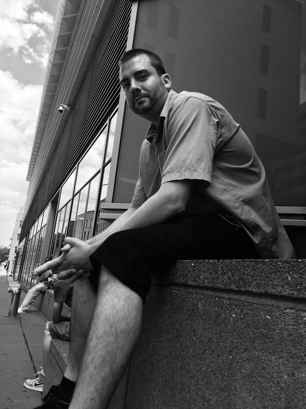 Anton waiting outside the Bronx Criminal Court.