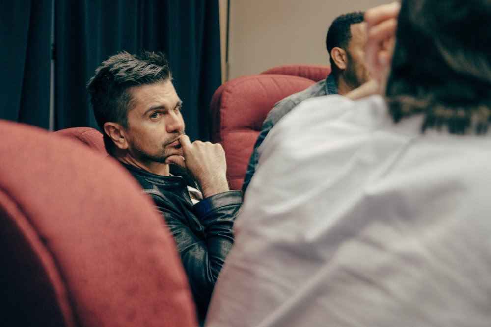 Juanes and John are briefed by the #FreeAmerica team.  Photo by Imani Lindsey