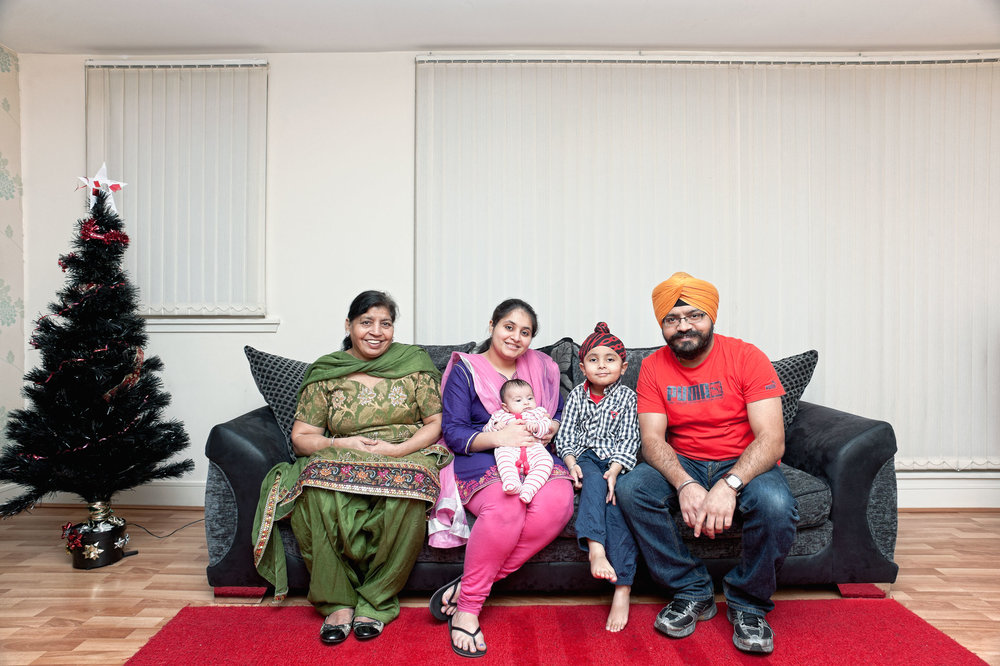 Sikh communities in Scotland have a long history, stretching back to the 19th century when the first families arrived from India. Scottish Sikhs have their own tartan and are often to be found wearing kilts on special occasions. This portrait shows a family who represent a more recent arrival to Scotland. Gurinder and his wife Harpreet came to Scotland from New Delhi with their son Brahmjot. Their daughter Siaana was born in Edinburgh; I was also lucky to meet Gurinder's mother Balbir who comes to Scotland every few months to visit and help her son and his wife with the family. Their religion is an intrinsic part of their own lives while also playing an important role in the wider community. Although traditional, they have also adopted some local customs, this Christmas tree for example.