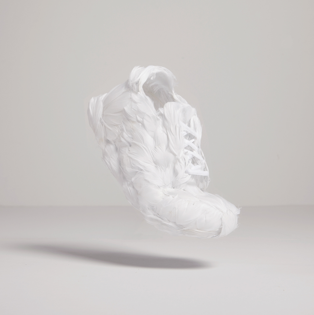 THE WHITE SWAN - A shoe that literally is light as a feather. Or a about one thousand, which is how many feathers it took to make this shoe.