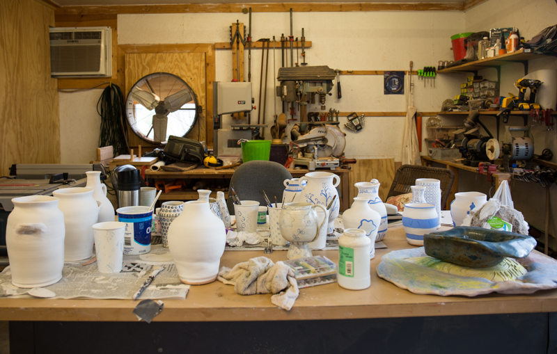 The table where I painted all of the vases. You can see my father's woodworking shop in the background. He creates beautiful wooden bowls and spoons. I hope to collaborate with him in the future.