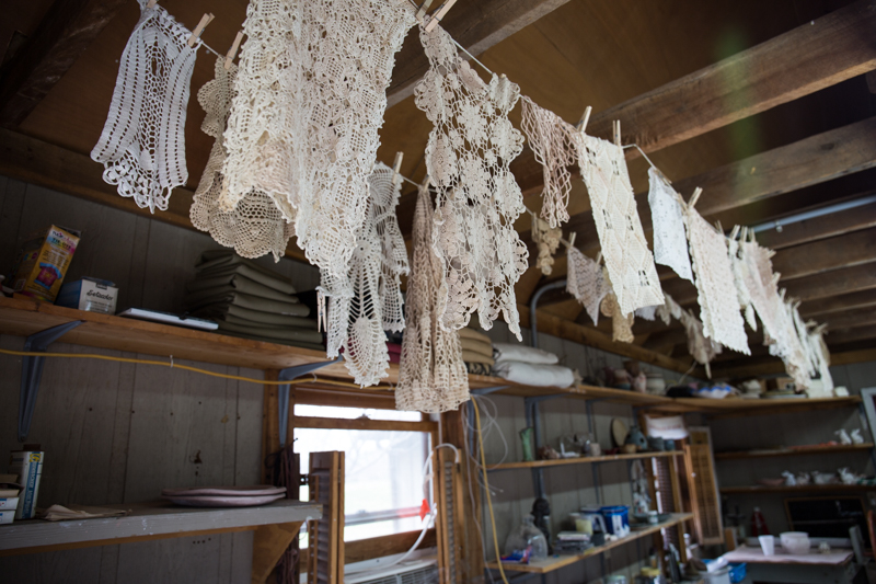 Crocheted doilies hanging at Ewell Farm Studio ready to be pressed into clay.