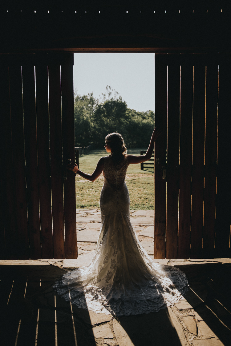 silhouette of country bride in barn doorway in carolina