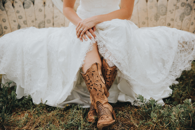 wedding dress and cowboy boots at triad wedding venue