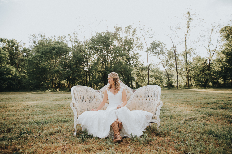 bride sitting on vintage loveseat in winston-salem location