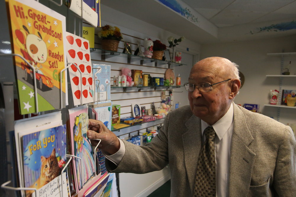 Jack Batten, pictured above at the Cape Albeon gift shop, embraces retirement through his volunteer work.