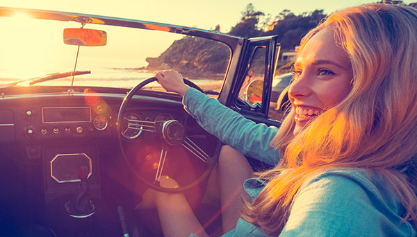 woman-driving-car-at-beach-600x342.jpg