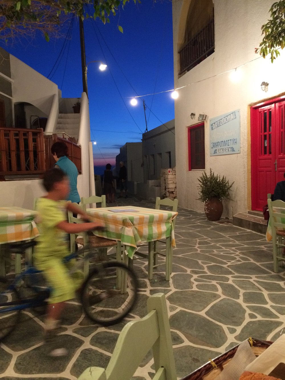 Enjoying an evening meal and local life in Chora under the night sky. Dinner included a local caper berry sauce made from capers picked fresh that day.