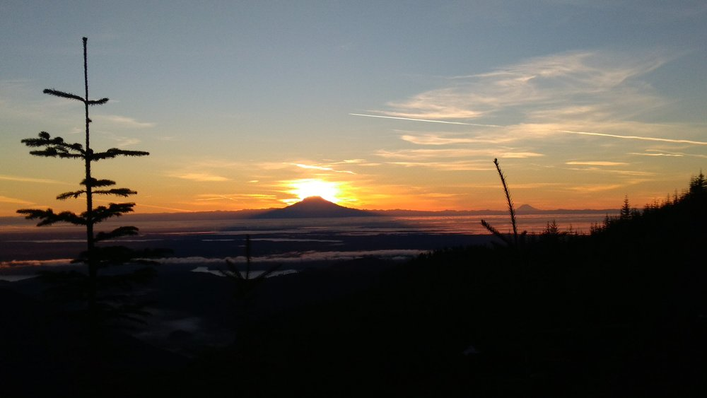Sunrise behind Mt. Rainier. View from the trailhead. To the left of Rainier was Mt. Baker and to the right Mt. Adams and Mt. St. Helen's. I think this was the best car camping sunrise I had ever seen.